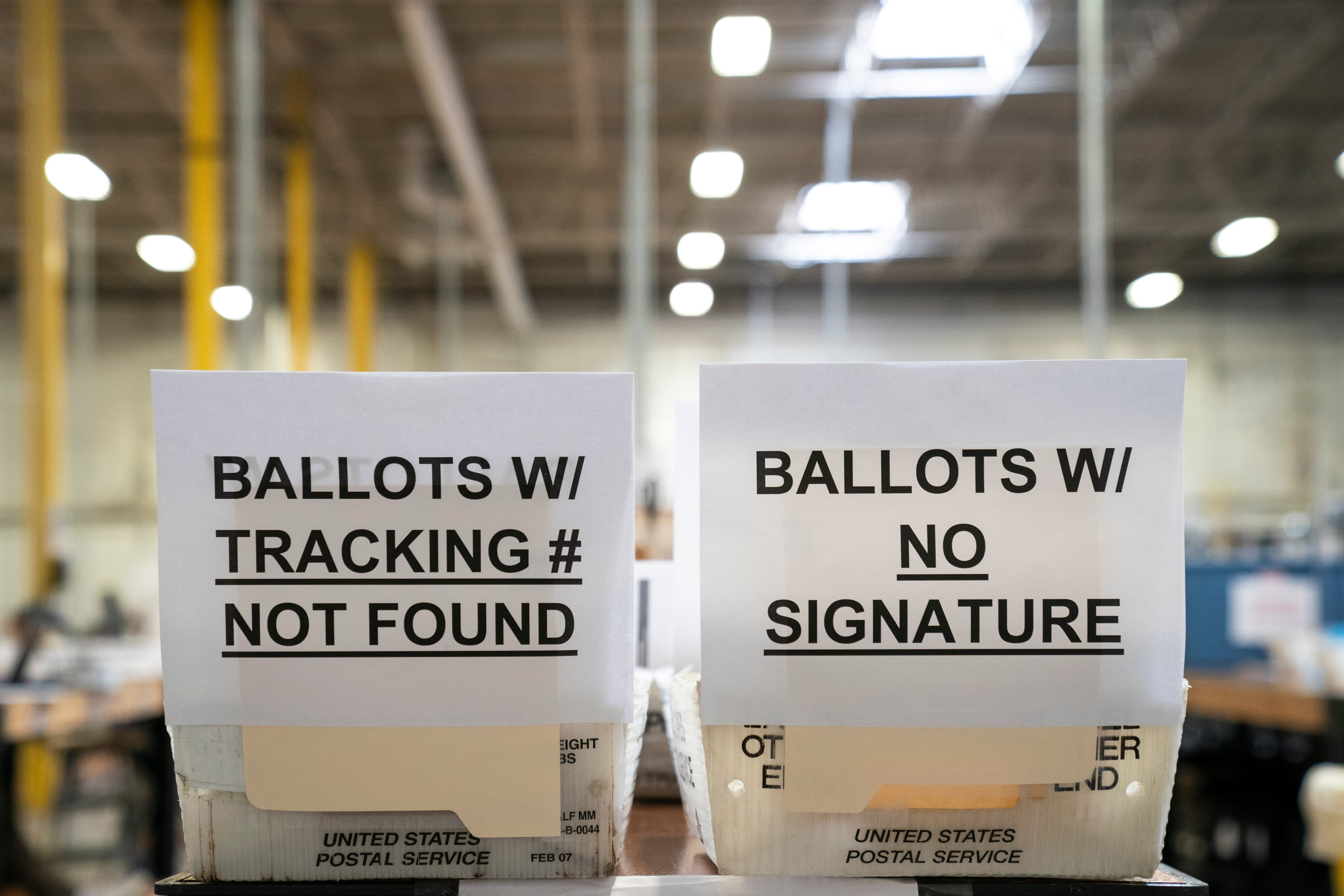 Each ballot at Maryland's Anne Arundel County Board of Elections headquarters goes through a five-step process before being sliced open and tabulated.