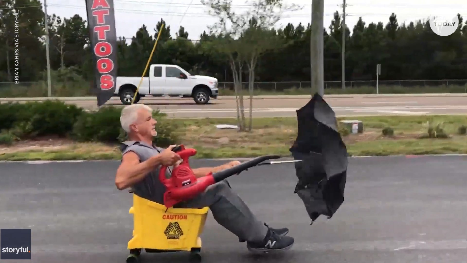 Man makes 'blue collar limousine' using a leaf blower, umbrella and mop bucket