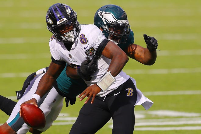 Malik Jackson of the Philadelphia Eagles sacks Lamar Jackson #8 of the Baltimore Ravens during the third quarter at Lincoln Financial Field on October 18, 2020 in Philadelphia, Pennsylvania.