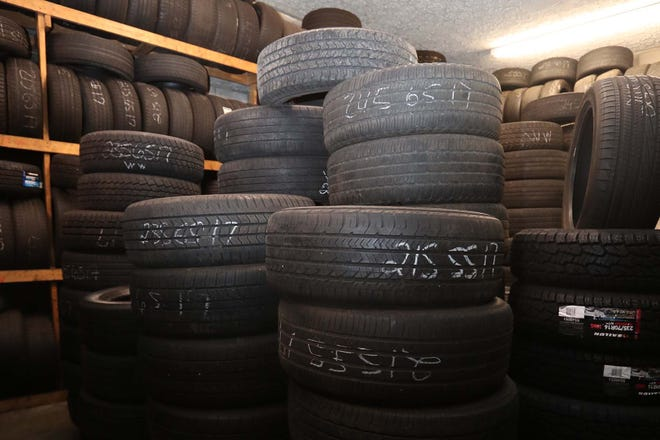 New and used tires are stored inside Copley Tire & Repair Shop on Tuesday in Akron.