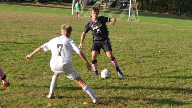 Burlington Township's Luke Andris (14) tries to work the ball around Austin Thiel of Bordentown during Monday's Burlington County Scholastic League game.