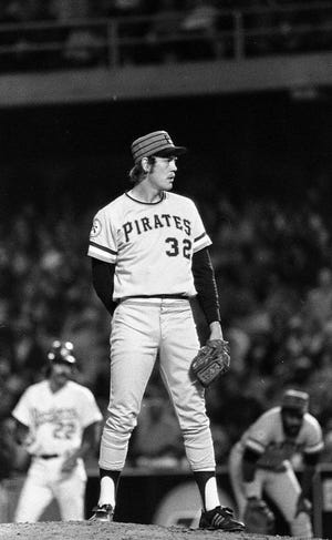 """George """"Doc"""" Medich, shown pitching for the Pittsburgh Pirates in 1976, won 124 games in his 10-year major league career."""