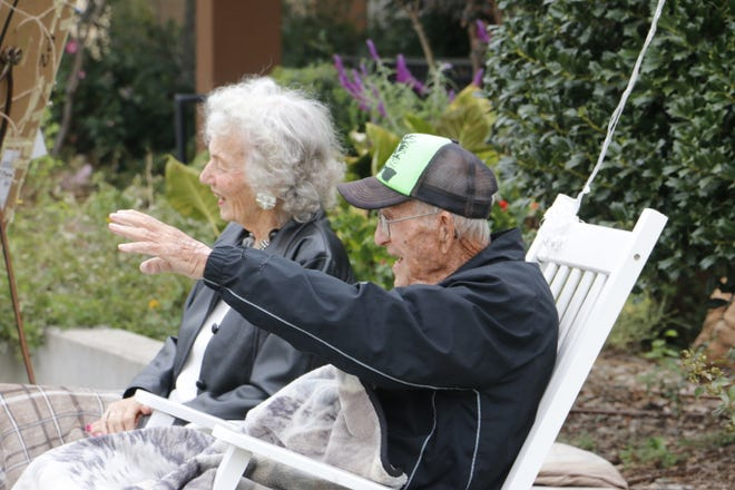 World War II veteran Bill Peirson celebrates his 106th birthday with a friend, Joan Murry, outside the Brownwood Senior Citizens Center Monday morning.