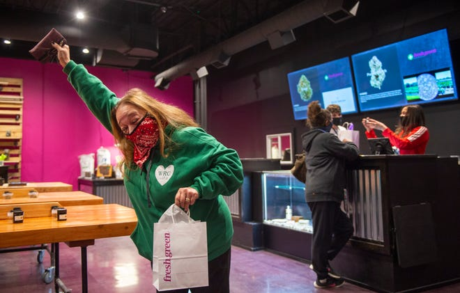 Shona Reinkemeyer was excited after she was legally able to purchase medical marijuana when it went on sale at Fresh Green, a dispensary that opened on Monday in Lee's Summit. It is the first dispensary to open in the Kansas City area.
