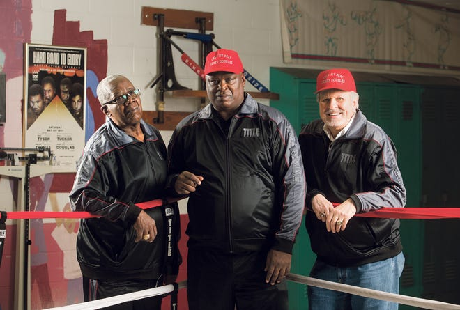 J.D. McCauley, left, with his nephew Buster Douglas and Douglas' former manager, John Johnson Sr., at Thompson Recreation Center in 2014.