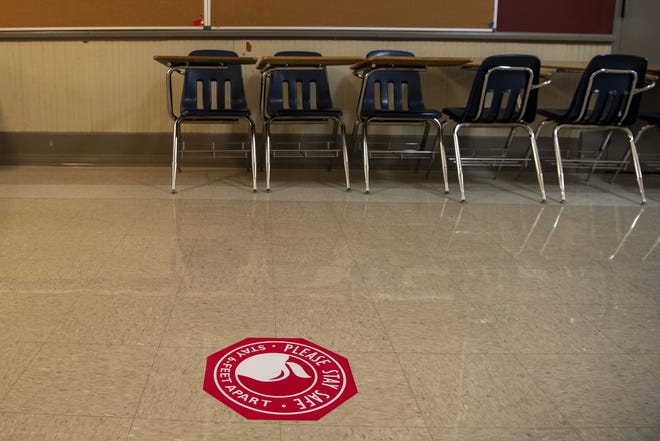 Signage to encourage social distancing was placed on the floor of a Southwood Elementary School classroom on Oct. 8. After abandoning plans to return students to buildings in October, Columbus City Schools officials are now preparing to reopen buildings to some students on Feb. 1.