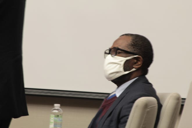 Former nurse's aide Patrick Osadebe listens during the first day of his trial on charges of rape and gross sexual imposition in Delaware Common Pleas Court. Osadebe, 51, is accused of sexually assaulting an elderly woman with dementia at the Inn at Bear Trail, an assisted-living facility off Old South State Road in Orange Township.