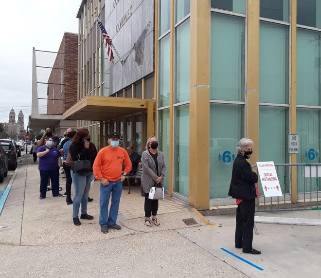 Residents line up Friday for early voting at the Lafourche Parish Registrar of Voters' Office in Thibodaux.