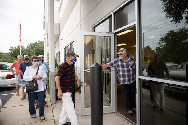 People enter one at a time as voting booths become available for early voting at the Supervisor of Elections Office in Tavares on Tuesday, Oct. 20. [Cindy Peterson/Correspondent]