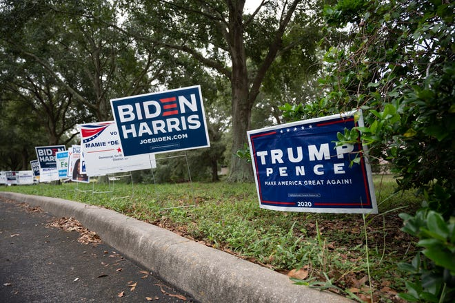 Political signs line the entrance at the Supervisor of Elections Office in Tavares. [Cindy Peterson/Correspondent]