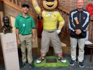 Barnesville junior Carter Wells, left, and head coach Jerry Robinson pose with Brutus during the recent OHSAA state golf tournament in Columbus. Wells became Barnesville's first golfer to qualify for the OHSAA state tournament.