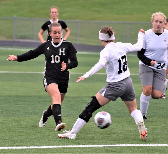 Gabby Schlabach shoots one past a Sandy Valley defender. The Hiland senior scored twice and assisted on another in Hiland's 7-0 win.