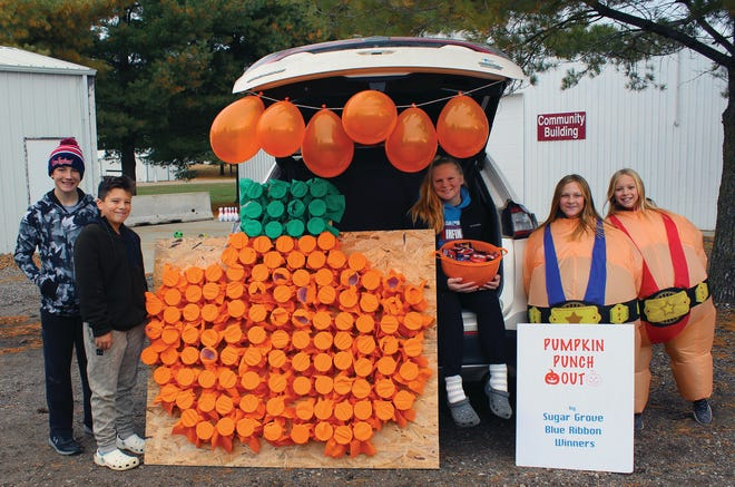 Owen Evans, Cole Radke, Kennedy Montag, Kale Montag Addie Bergthold by the Sugar Grove Blue Ribbon Winners trunk during Trunk or Treat at the Dallas County Fairgrounds in 2019.