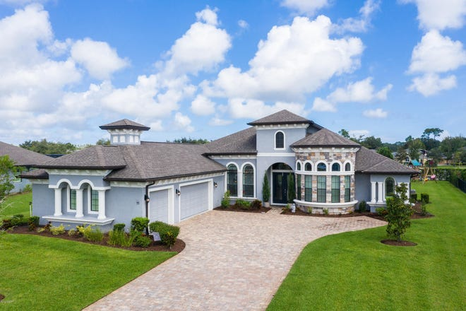 This masterfully laid out and designed Tomoka Ridge Way estate offers majestic curb appeal, with a beautiful paver driveway and walkway.