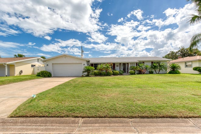 This beautifully maintained pool home on Surfside Drive in Ormond Beach is within walking distance of the beach and river.