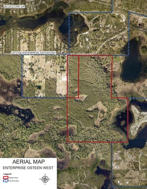 An aerial map shows the boundaries of Enterprise Osteen West, an amendment proposing to change a parcel of 95.34 acres from Volusia County Rural to City Low Density Residential, which allows for up to six units per acre.