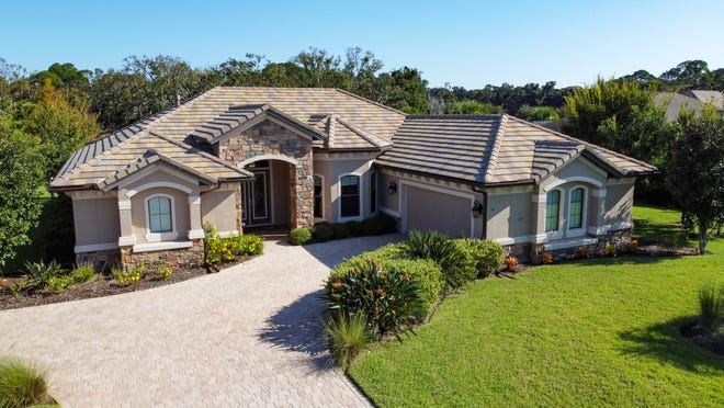 Nestled on nearly half an acre in the sought-after Palm Coast community of Wild Oaks, this beautifully designed custom estate was built by ICI Homes.