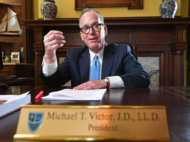 Mercyhurst University President Michael Victor is shown July 28 in his office at Old Main on the Erie campus. Victor, 59, is a  finalist for the presidency of West Liberty University in West Virginia.