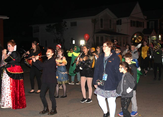 Costumed musicians and families march in Hornell's annual Halloween Parade last October. Hornell officials are advising against traditional trick or treating on Oct. 31, citing a spike in local COVID-19 infections.