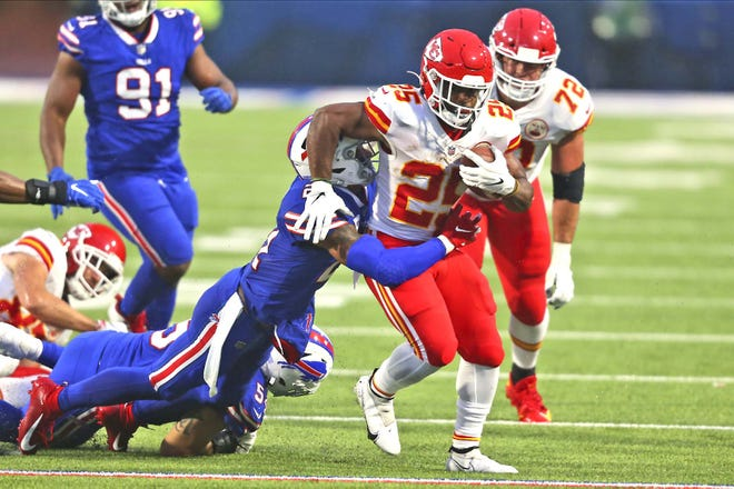 Kansas City Chiefs running back Clyde Edwards-Helaire (right) runs the ball during the first half of Monday's game against the Buffalo Bills in Orchard Park, New York.