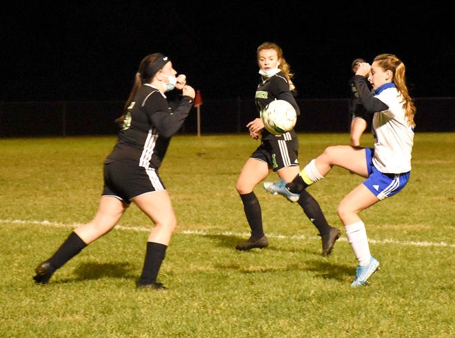 Dolgeville Blue Devil Rylee Lamphere (right) takes control of the ball during the second half of a match against Herkimer played Friday, Oct. 16, 2020, in Herkimer, New York.