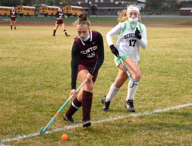 Clinton Warrior Hannah Litz advances the ball along the sideline with Caitlyn Vriesen (right) defending for Herkimer during the second half of Friday's game played in Herkimer, New York.