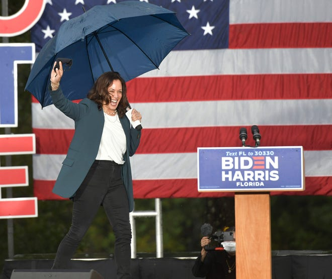 Democratic vice-presidential candidate Kamala Harris speaks during a drive-in rally Monday at UNF.