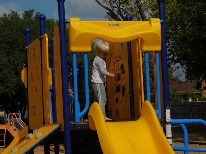 David Toombs plays on new playground equipment  at Hillcrest Park in Sherman Monday. The new equipment was made possible through a $10,000 donation by the Sherman Rotary Club.
