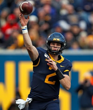 West Virginia quarterback Jarret Doege throws a pass against Texas Tech during the Red Raiders' 38-17 victory last year. This week, the two teams play at Jones AT&T Stadium, where Doege's brother Seth threw for six touchdowns and a career-high 499 yards in a 49-14 rout of the Mountaineers in 2012.