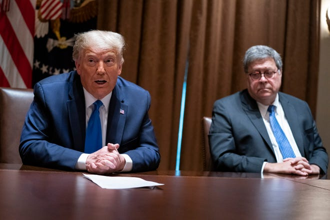 Attorney General William Barr listens last month as President Donald Trump speaks during a meeting with Republican state attorneys general in the Cabinet Room of the White House in Washington. The relationship between President Donald Trump and top ally Attorney General William Barr is fraying over the lack of splashy indictments so far in the Justice Department's investigation into the origins of the Russia probe, according to people familiar with the matter.