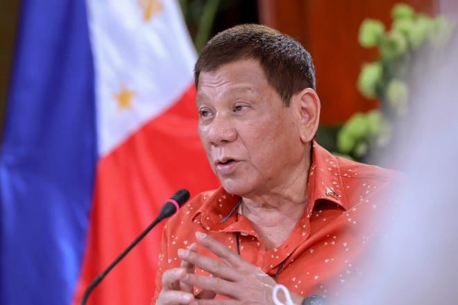 Philippine President Rodrigo Duterte speaks during a meeting at the Malacanang presidential palace in Manila, Philippines, on Monday. The Philippine president has said he could be held responsible for the thousands of killings under his anti-drugs crackdown and was ready to face charges, except crimes against humanity, that could land him in jail.