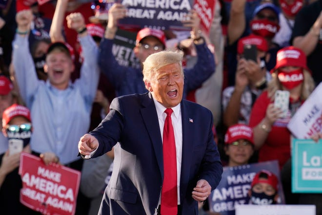 President Donald Trump works the crowd after speaking at a campaign rally Monday in Tucson, Ariz.
