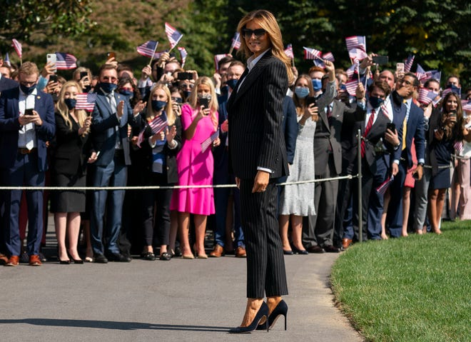 First lady Melania Trump pauses as she and President Donald Trump walk to board Marine One at the White House on Sept. 29 in Washington for the short trip to Andrews Air Force Base en route to Cleveland for first debate against Democrat Joe Biden.