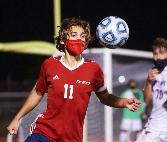 Sam Stamoulis of Portsmouth keeps his eyes on the ball during Monday night's game against visiting Mount Hope.