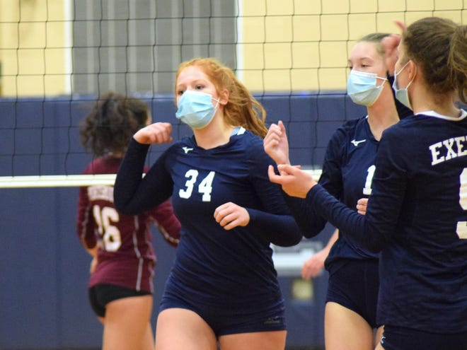 Exeter High School senior Becca Antonellis (34) reacts with teammates, including Arianna Degenaars (1) during Monday night's Division I volleyball match against Portsmouth.