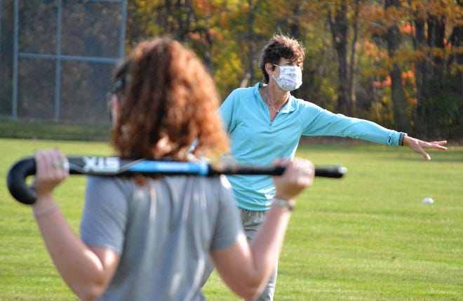 York High School field hockey coach Barb Marois goes over a drill during Monday's first practice of the season.