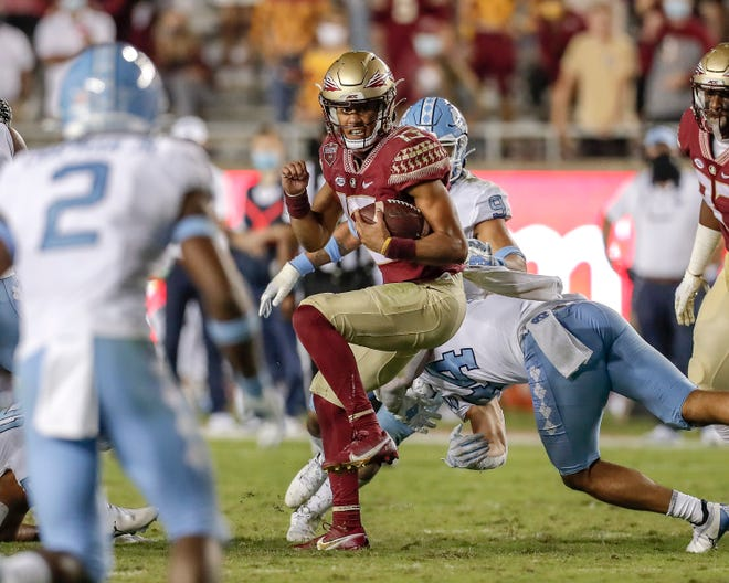 Florida State quarterback Jordan Travis rushes against North Carolina on Saturday. Travis, a former Benjamin and Palm Beach Central standout, led the Seminoles to a 31-28 win over UNC.