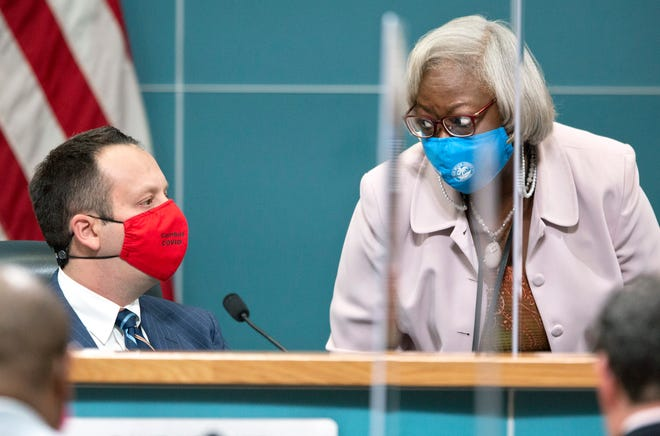 Palm Beach County Mayor Dave Kerner (left) is seen talking with County Administrator Verdenia C. Baker on Tuesday, Oct. 20, 2020, when county commissioners approved another $20 million for a grant program designed for businesses impacted by the coronavirus pandemic.