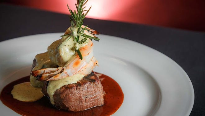 A touch of surf and turf at Okeechobee Steakhouse: tenderloin medallions topped with jumbo shrimp in a portobello demi-glaze and bearnaise sauce.