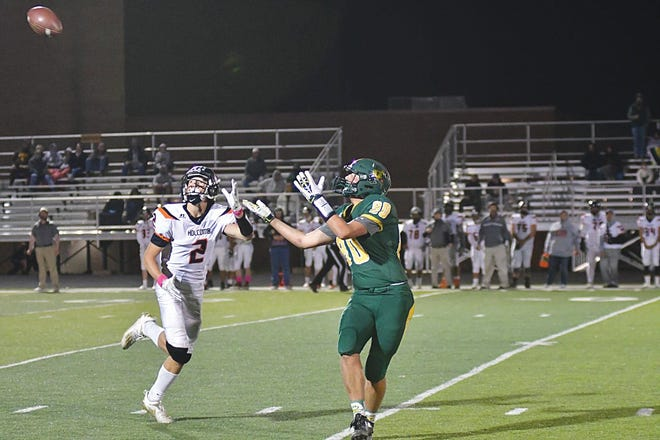 Pratt High School football player Grant Younie finds his position to catch a the ball as the Greenbacks play Holcomb on Zerger Field, Friday, October 16.