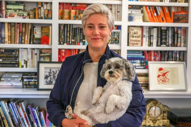 """""""Plain Bad Heroines"""" author Emily M. Danforth, with dog Kevin, at her home in Pawtucket, a historic lyceum that originally housed the Pawtucket Progressive Spiritualists."""