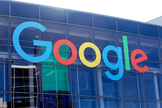 In this Sept. 24, 2019, file photo a sign is shown on a Google building at their campus in Mountain View, Calif. The Justice Department filed a lawsuit Tuesday alleging that Google has been abusing its online dominance in online search to stifle competition and harm consumers. (AP Photo/Jeff Chiu, File)