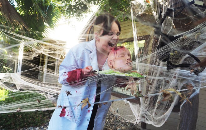 Changes Faces Theater Company's Alice Hewitt is covered with webs in a scene they will stage during haunted drive-thru.