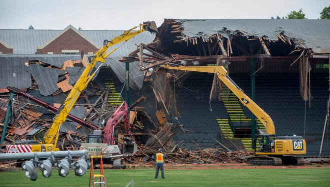 Crews demolish the East Grandstand at Hayward Field in June 2018. The grandstands, built in 1925, were torn down to make way for the new track and field stadium.
