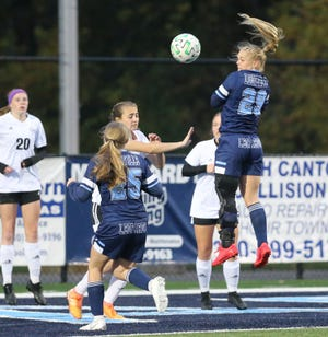 Morgan Keelan (25) and Matti Benson (29) of Louisville go for a header off a corner kick during their Division I girls sectional soccer game against Cuyahoga Falls at Louisville on Monday, Oct. 19, 2020.