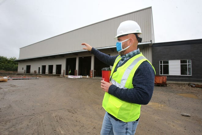 Dan Flowers, president and CEO of the Akron-Canton Regional Foodbank, leads a tour of their new location that is under construction in Canton on Tuesday, Oct. 20, 2020.