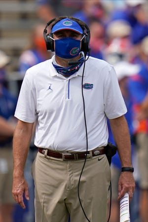"""Florida coach Dan Mullen, who announced Saturday he tested positive for COVID-19, said Wednesday, """"I'm doing fine, thank you for asking"""" on the SEC teleconference."""