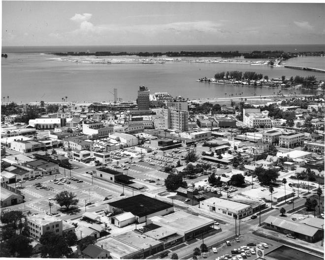 Downtown Sarasota, 1960, before the glut of condominiums which characterizes the area today. Note in the background Bird Key being constructed.