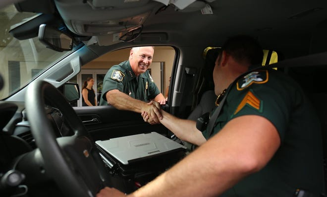 Retiring Sheriff Tom Knight greeted well-wishers during a parade of gratitude Oct. 19 at sheriff's headquarters in Sarasota.