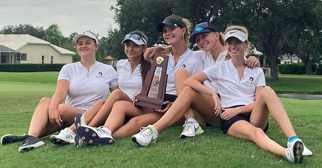 The Riverview High girls golf team pose with the championship trophy after winning the Class 3A-Region 3 tournament Tuesday at Misty Creek Country Club in Sarasota.